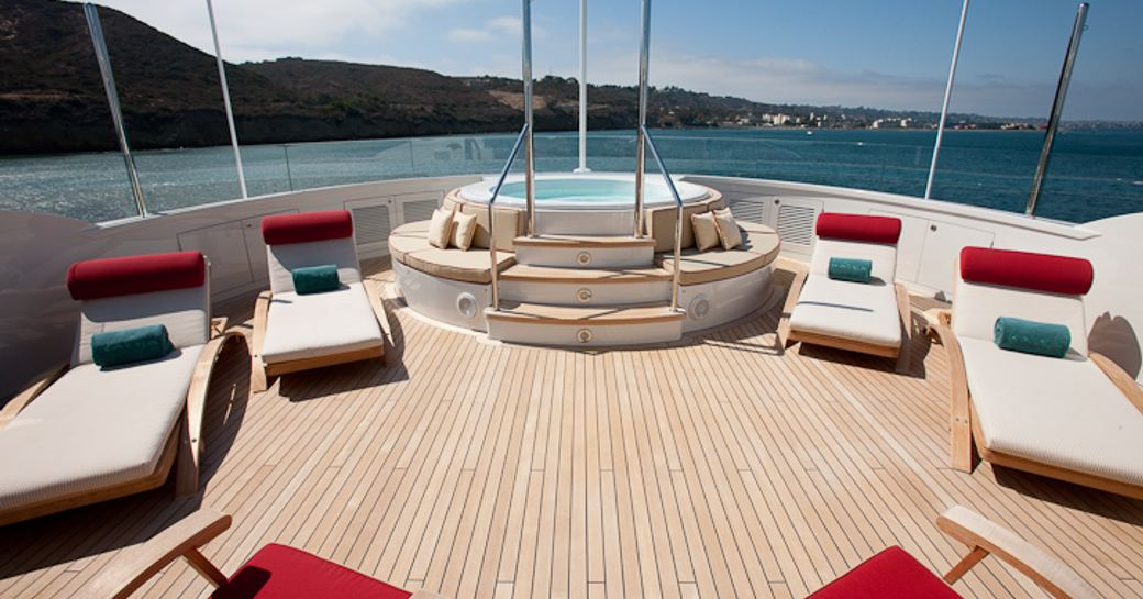 The jacuzzi and sunloungers placed on the sundeck of superyacht KATYA