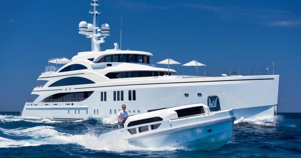 Superyacht 11/11 underway with her limousine tender