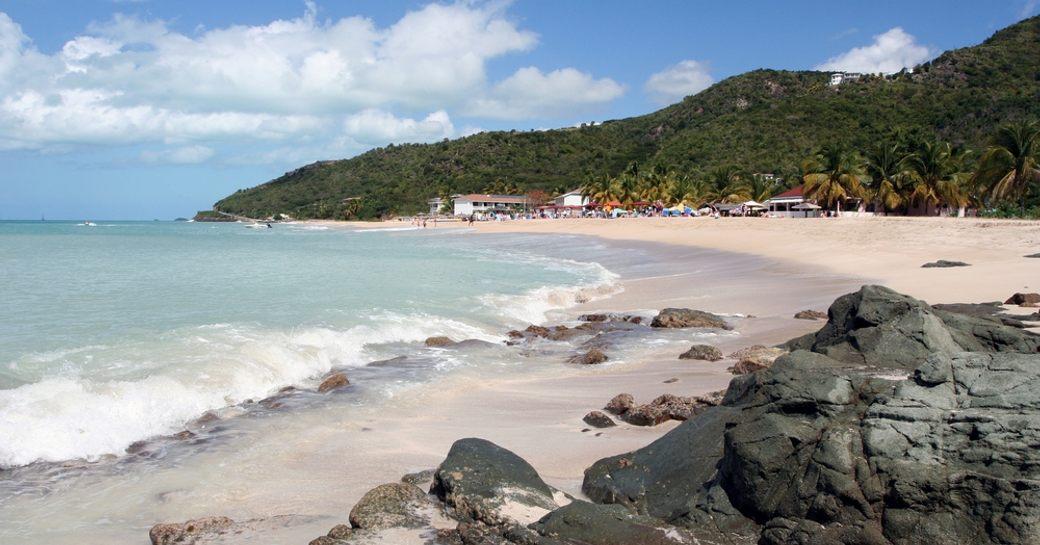 beach at prickly pear island in antigua