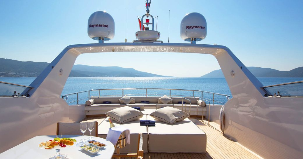 the outdoor deck of a luxury charter yacht