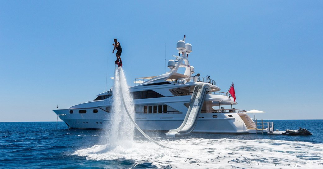a man using the on board water toys of the luxury yacht he is chartering through the Mediterranean