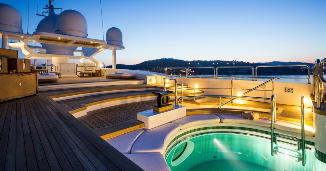 An underlit Jacuzzi on the exterior of a superyacht