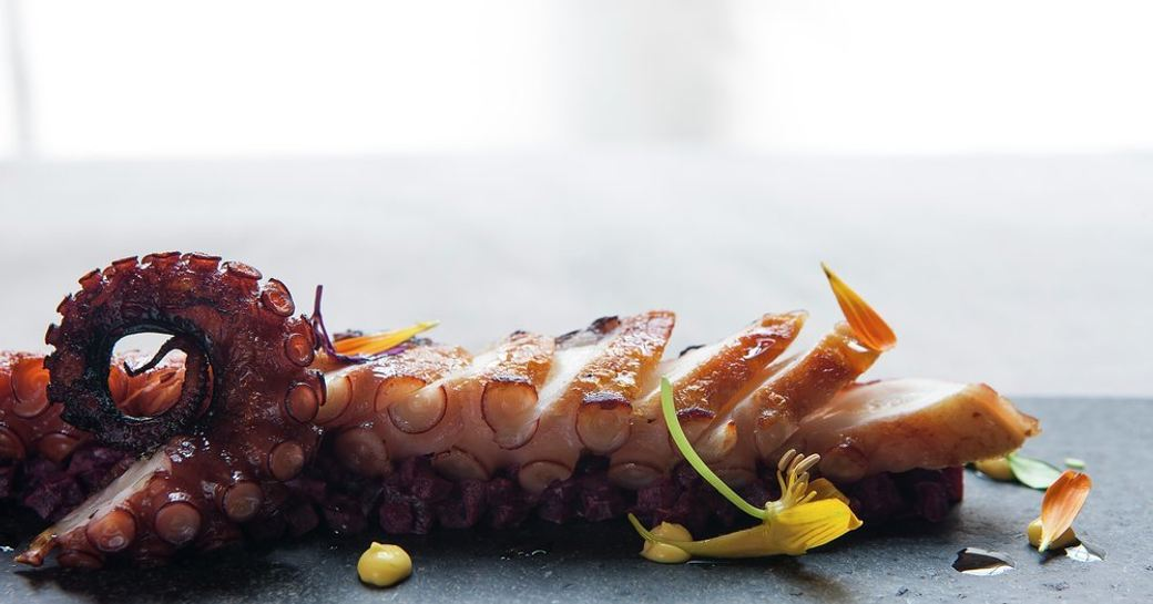 octopus being served on luxury yacht