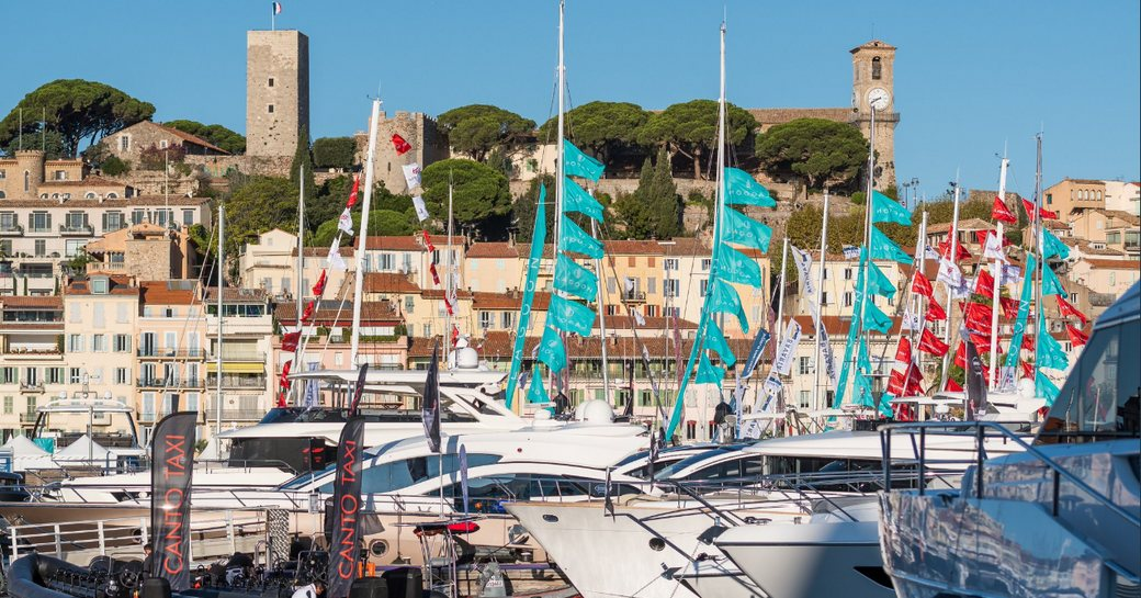 yachts at Cannes Yachting Festival with iconic tower in background