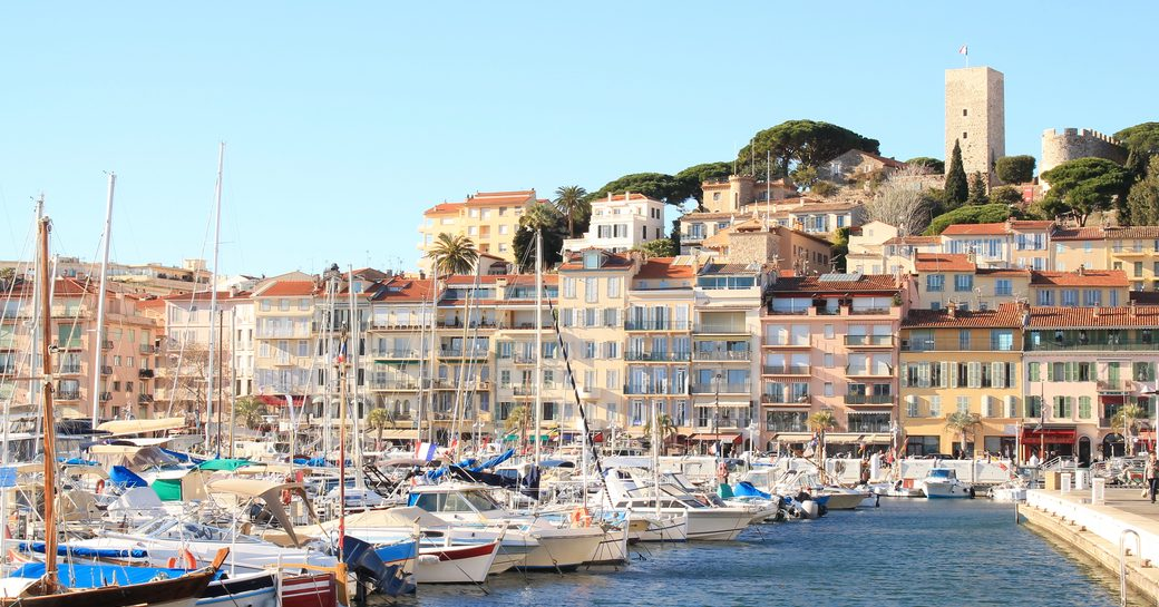 Overview of Vieux Port in Cannes, many sailing boats berthed.