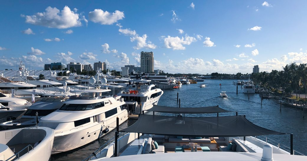 Yachts at FLIBS 2019, with river canal and city skyline in background