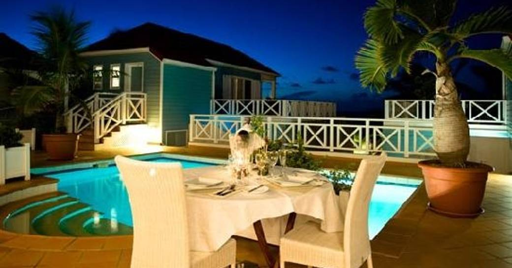 outdoor seating by pool at La Langouste restaurant in St Barts
