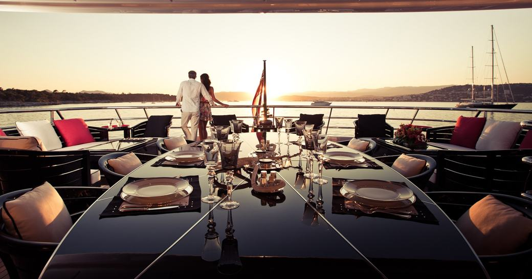 black lacquer table on upper deck aft at dusk on board superyacht 'Step One'