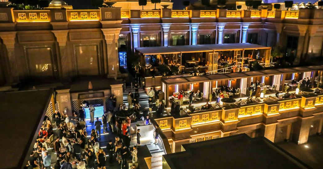 busy Hakkasan restaurant with guests at bar and sitting down to dine at Emirates Palace in Abu Dhabi
