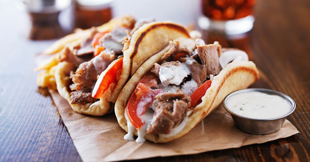 lamb gyro with greek salad and tzatziki sauce served in Greece