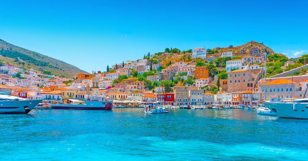 Crystal blue shores of old main port in Hydra, Greece