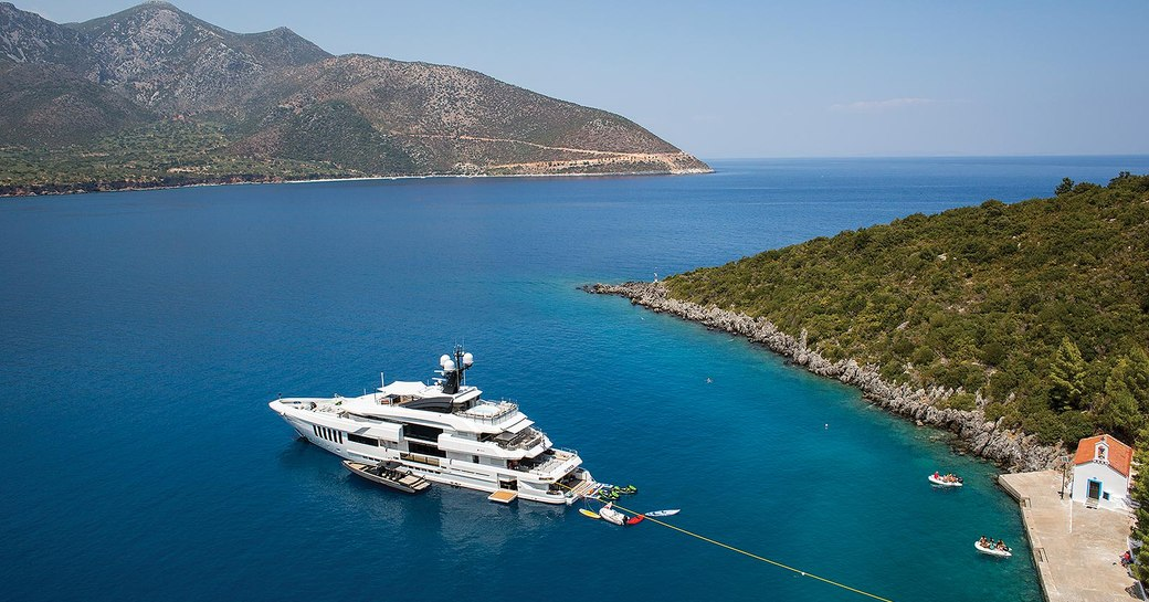 Charter yacht at anchor in a quiet cove in greece