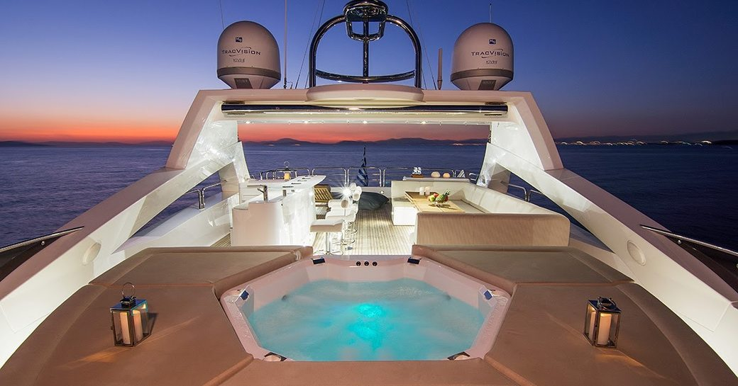 The Jacuzzi surrounded by sunpads on board superyacht PATHOS