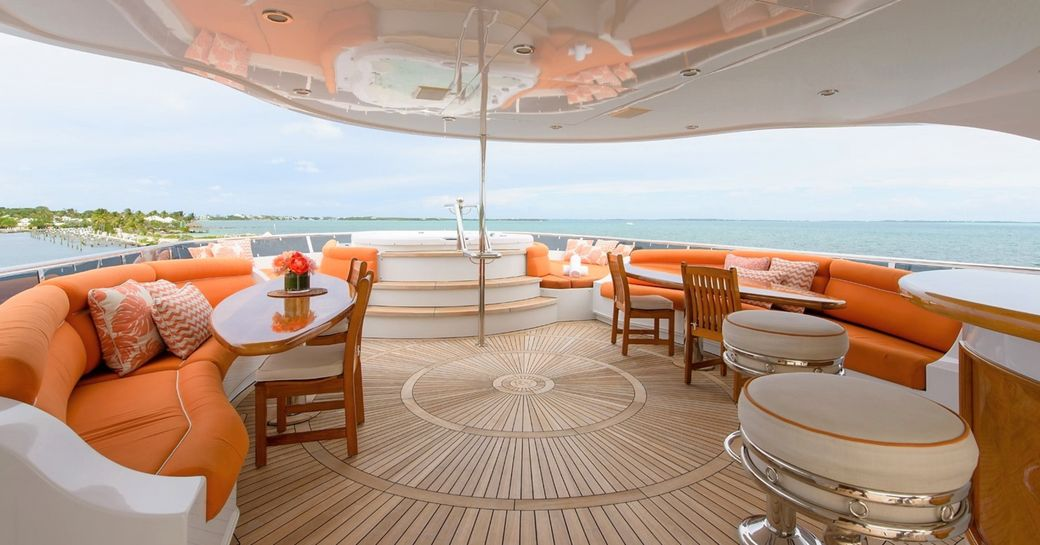 jacuzzi, seating and bar stools on the sundeck of luxury yacht EXCELLENCE