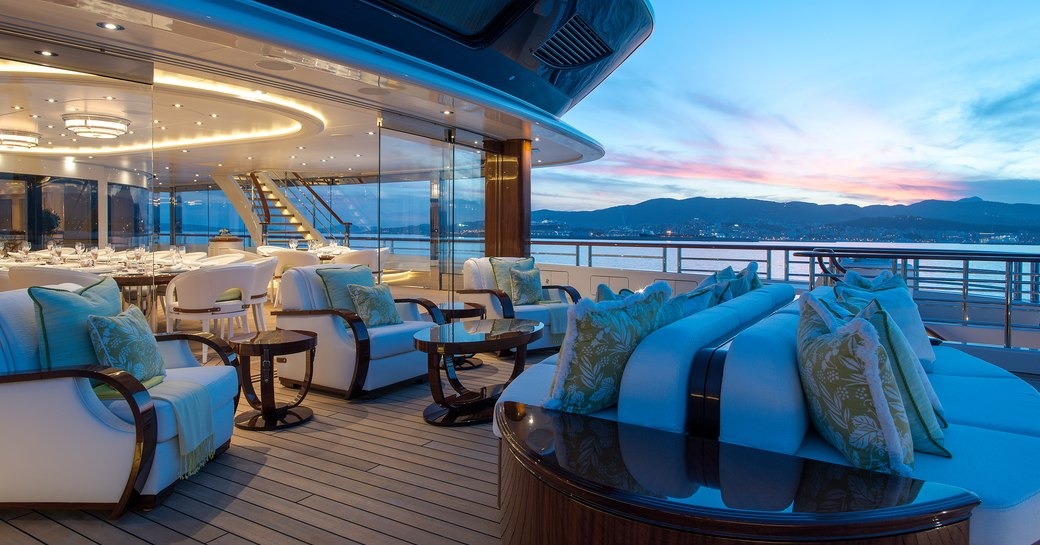 Alfresco lounging and dining area on superyacht TIS