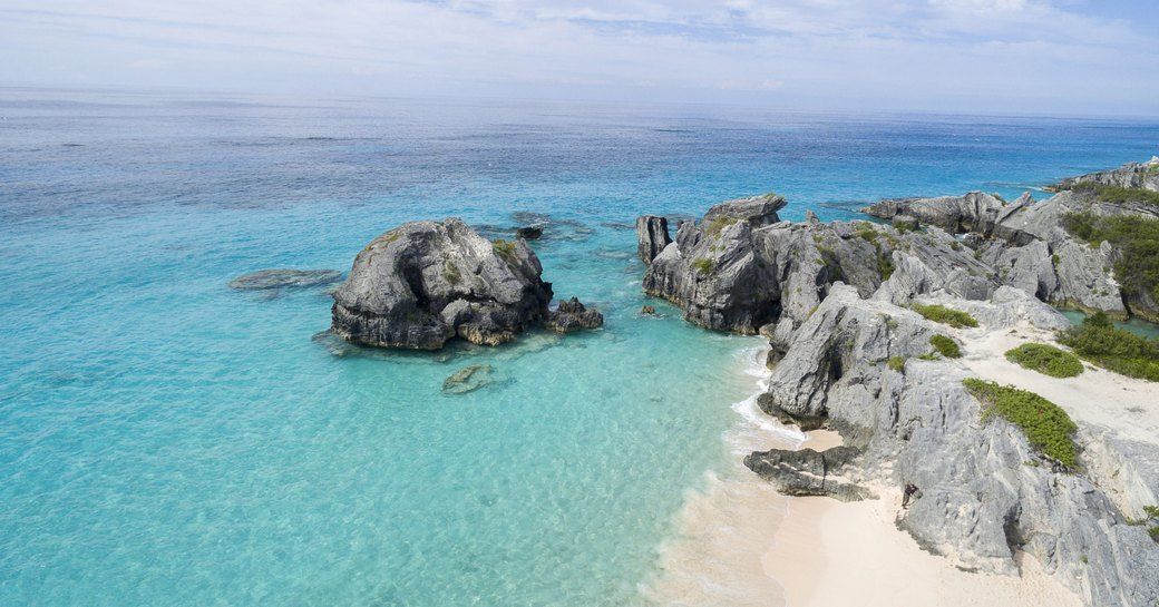white sand, rocky cliffs and turquoise waters of Bermuda
