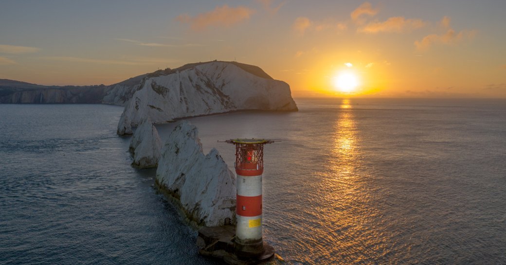 the needles rock formation in isle of wight at sunset