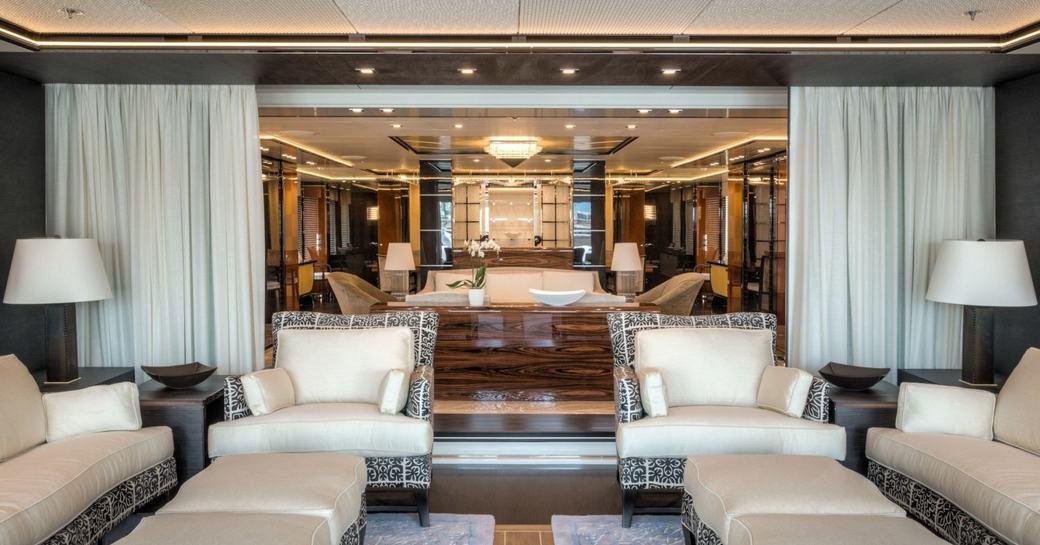 inside/outside veranda and main salon beyond aboard superyacht Party Girl
