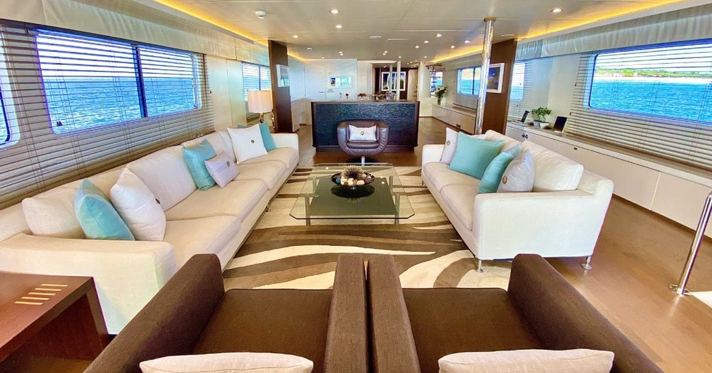 Bright interiors with sofas, armchairs and table on superyacht LIONSHARE