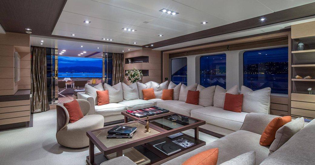 large L-shaped sofa in the main salon aboard superyacht DYNAR