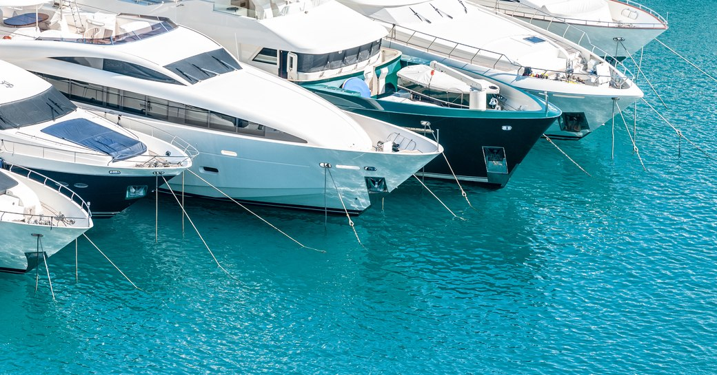yachts berthed in marina