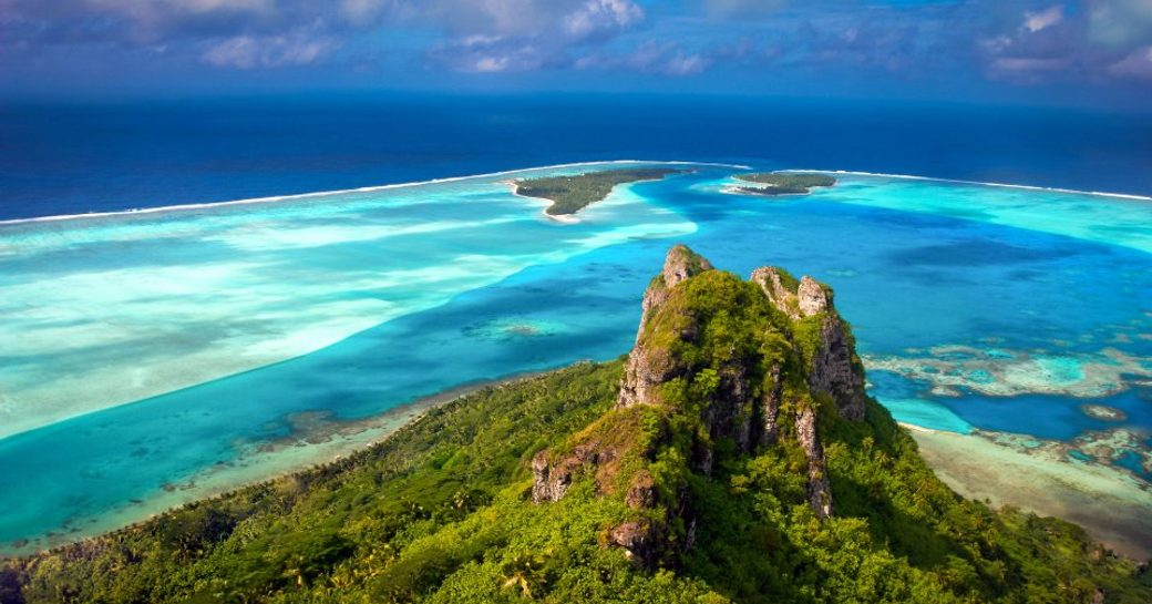 the coast of Tahiti accessible by luxury charter yacht
