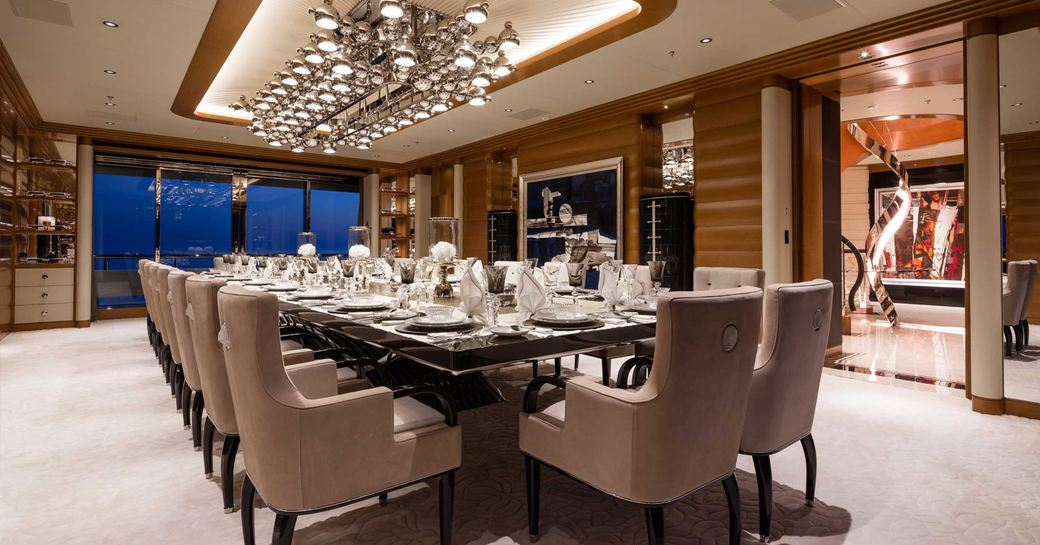 formal dining table and art installation on board charter superyacht lana