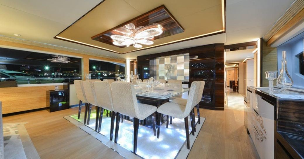 sophisticated dining area in main salon of charter yacht 'Ghost II'
