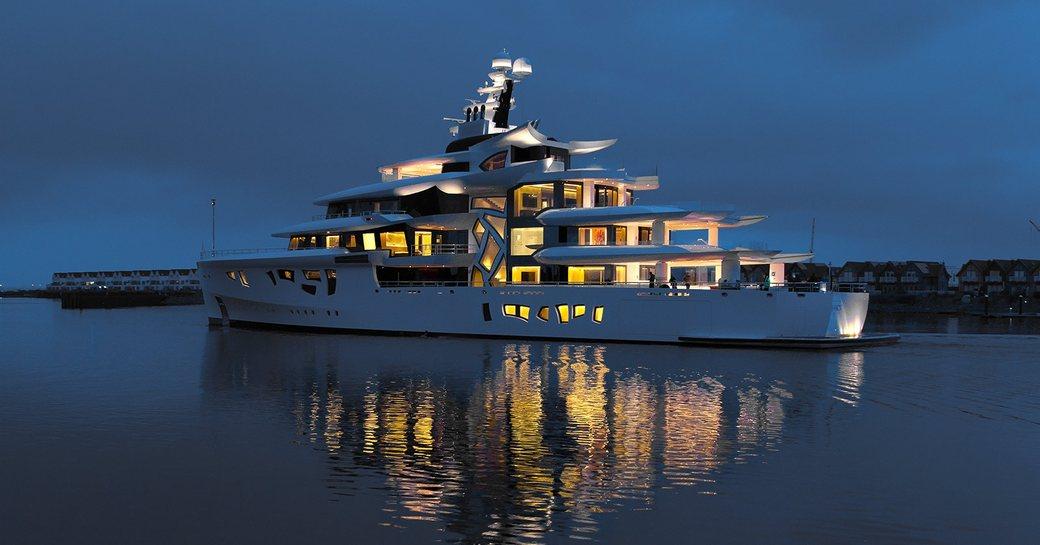 ARTEFACT yacht lit up at night