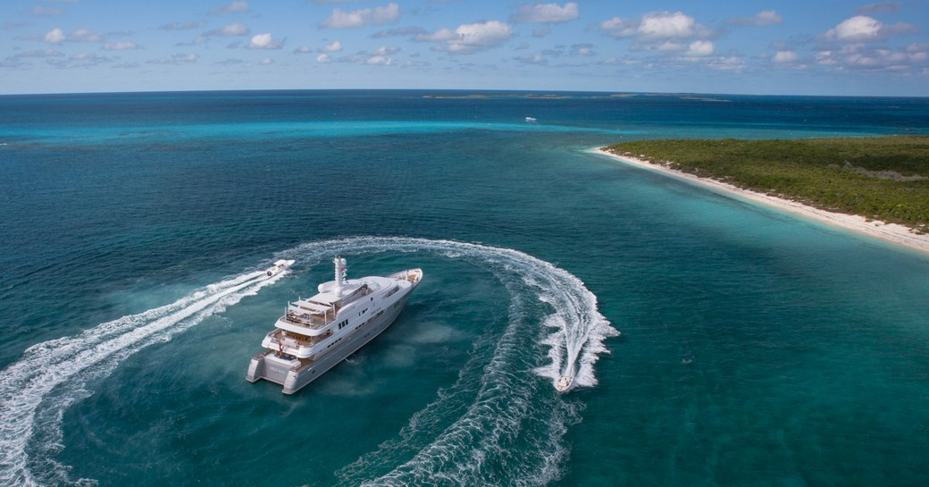 luxury superyacht in the caribbean with jet-skis alongside