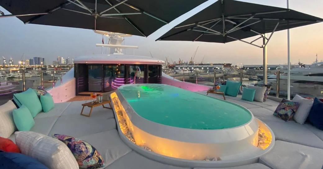 Covered area of sunpads on deck of superyacht Sea Rhapsody