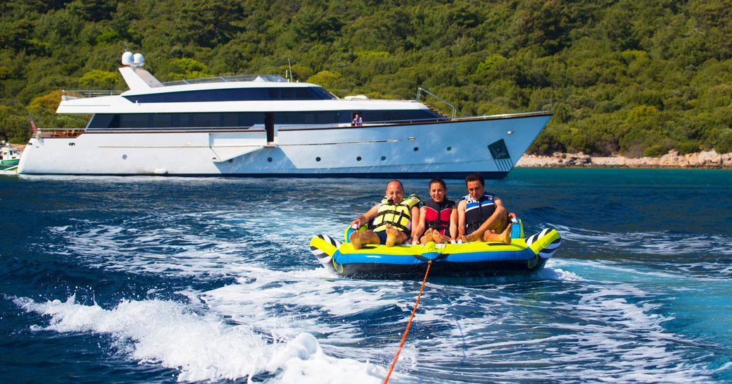 charter guests enjoy water toys on their vacation