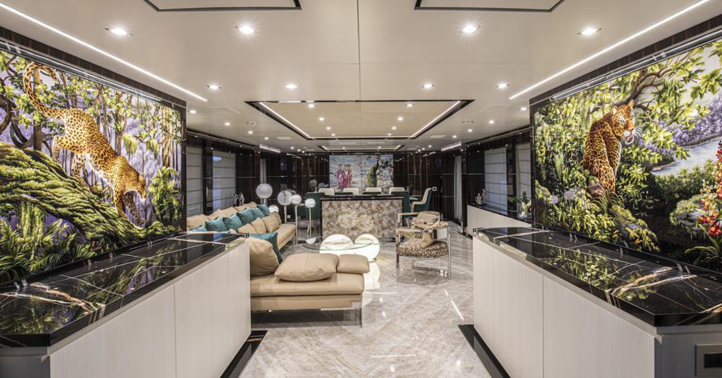 lobby and reception area with grey marble accents on benetti yacht happy me