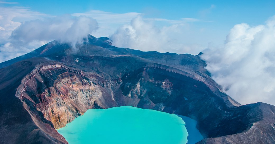 Crater of Gorely volcano with an acid lake