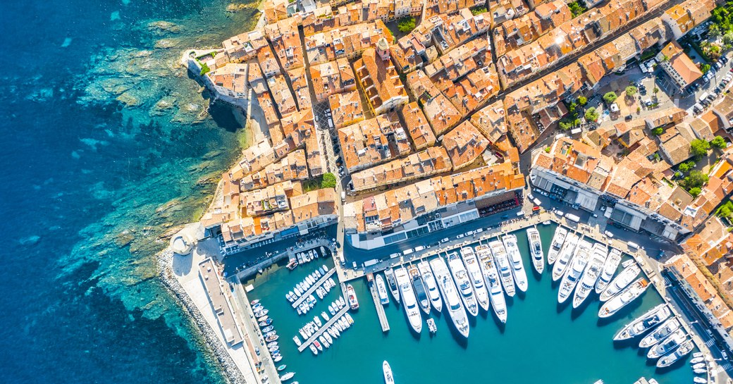 a busy port in the amalfi coast with many superyachts berthing to enjoy the Mediterranean while on their luxury yacht charter