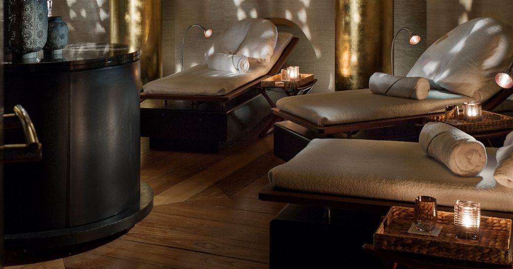 A selection of beds arranged around an indoor spa in Antigua