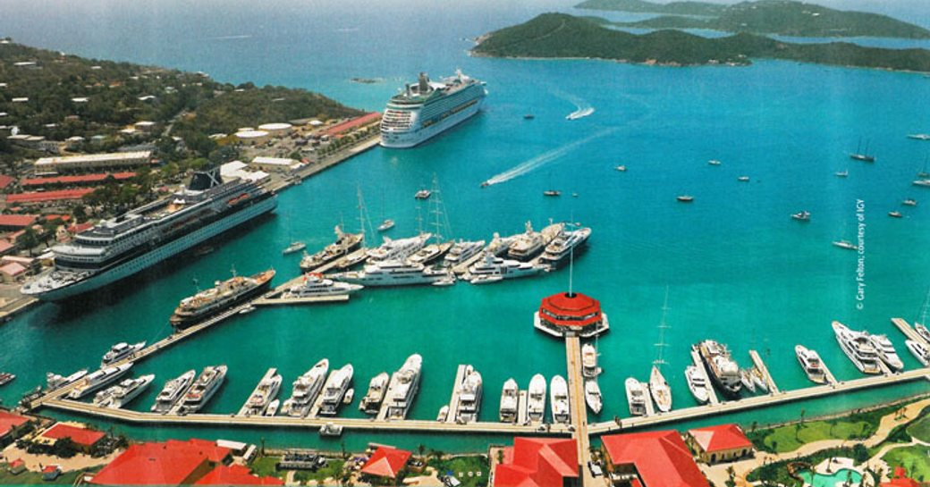 An aerial shot of superyachts berthed in a Caribbean marina
