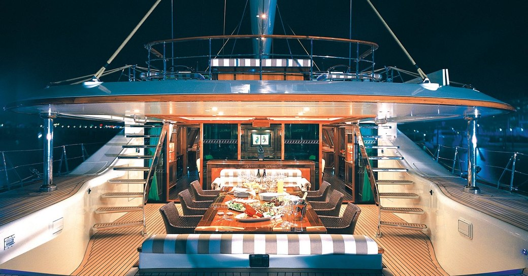 cockpit set up for dinner at night time aboard charter yacht TIARA