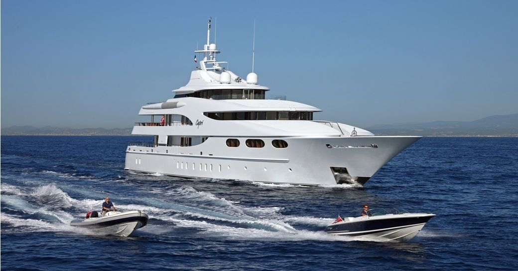 motor yacht CAPRI cruises on a luxury yacht charter alongside two tenders