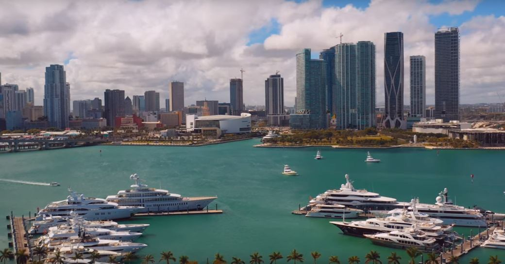 panoramic shot of superyachts lined up at superyacht miami
