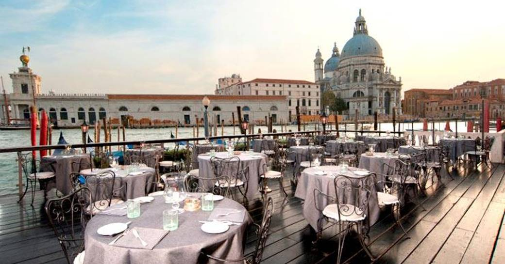 dine at De Pisis Restaurant, Bauer Hotel on a venice film festival yacht charter