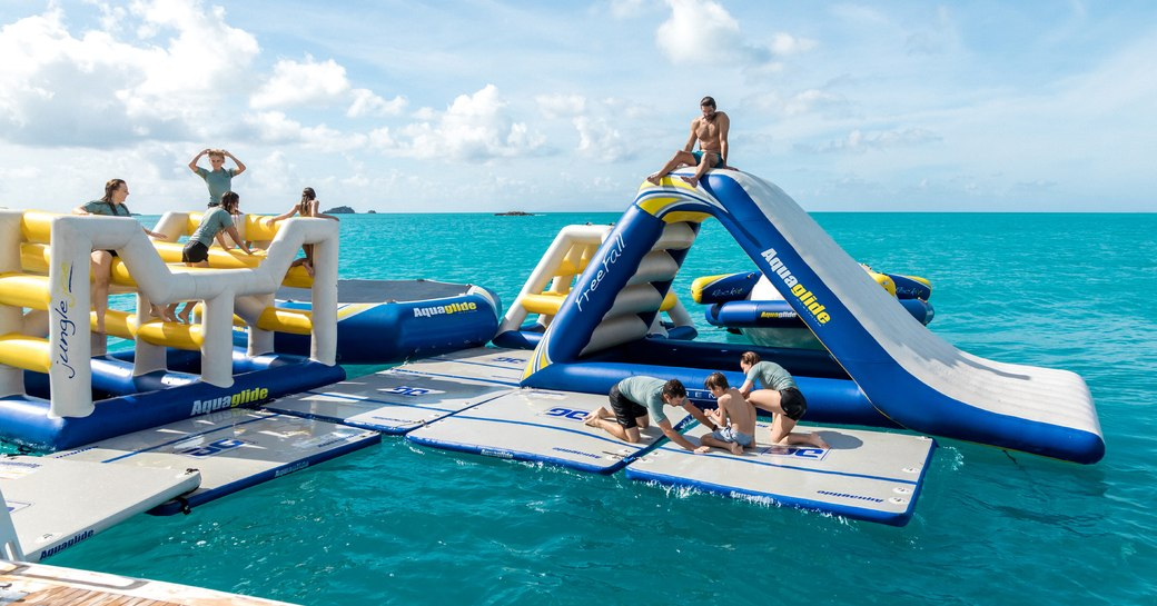 Charter yacht TITANIA's stand-out selection of water toys, including an inflatable water park, slides and trampoline