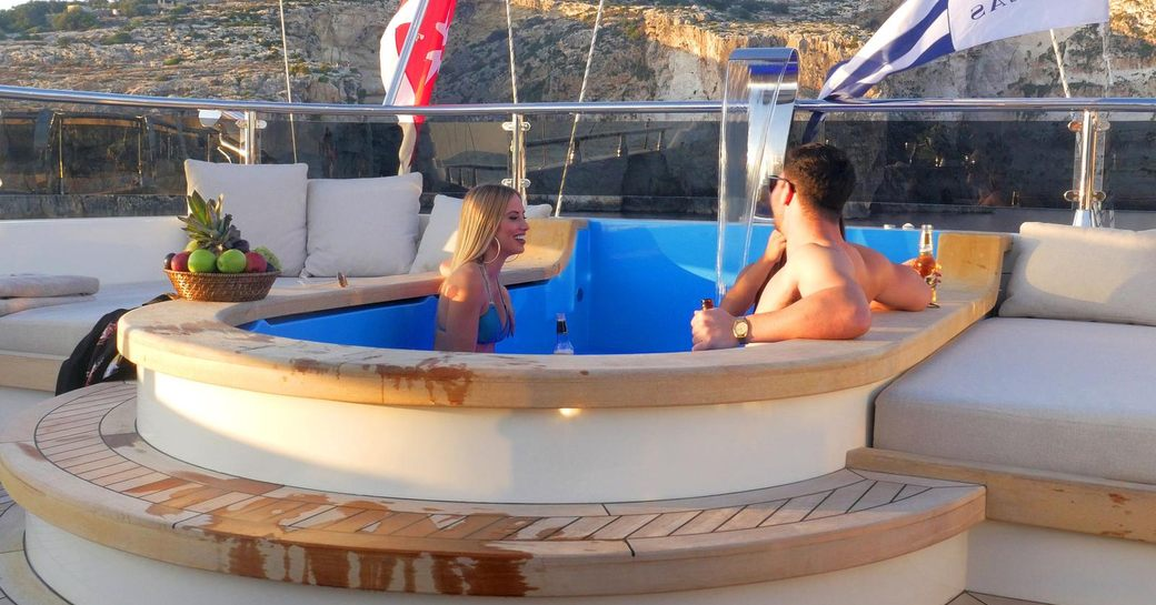 Two people relaxing in spa pool on luxury sailing yacht ARESTEAS