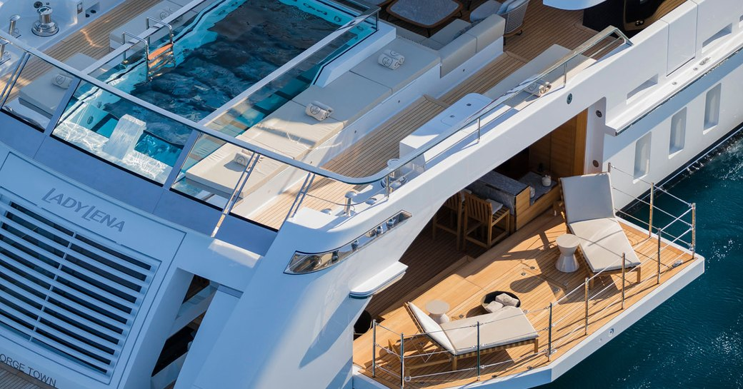 Aerial shot of glass bottom swimming pool and side deck of superyacht Christina O