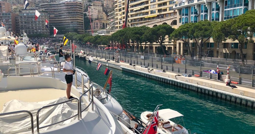 A yacht stewardess looking across the Monaco Grand Prix circuit