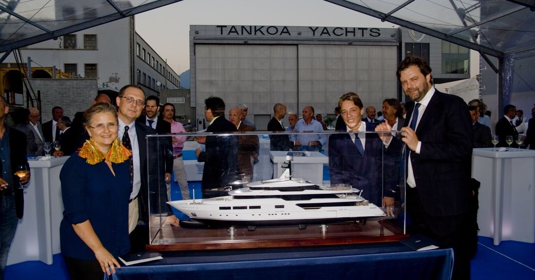 team behind superyacht suerte gather at launch at tankoa yachts in july
