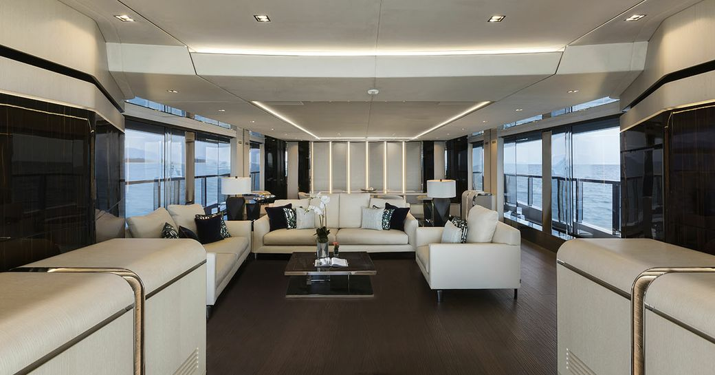 charter yacht EVA. 4EVA bright and breezy main salon with minamilst features that carry throughgout