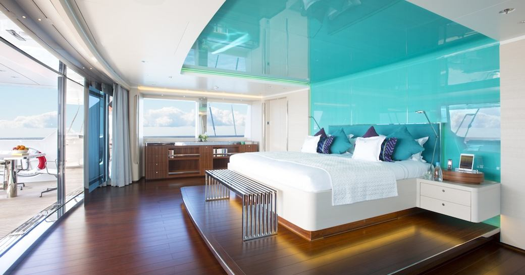 master cabin superyacht aquijo, with turquoise ceiling panels