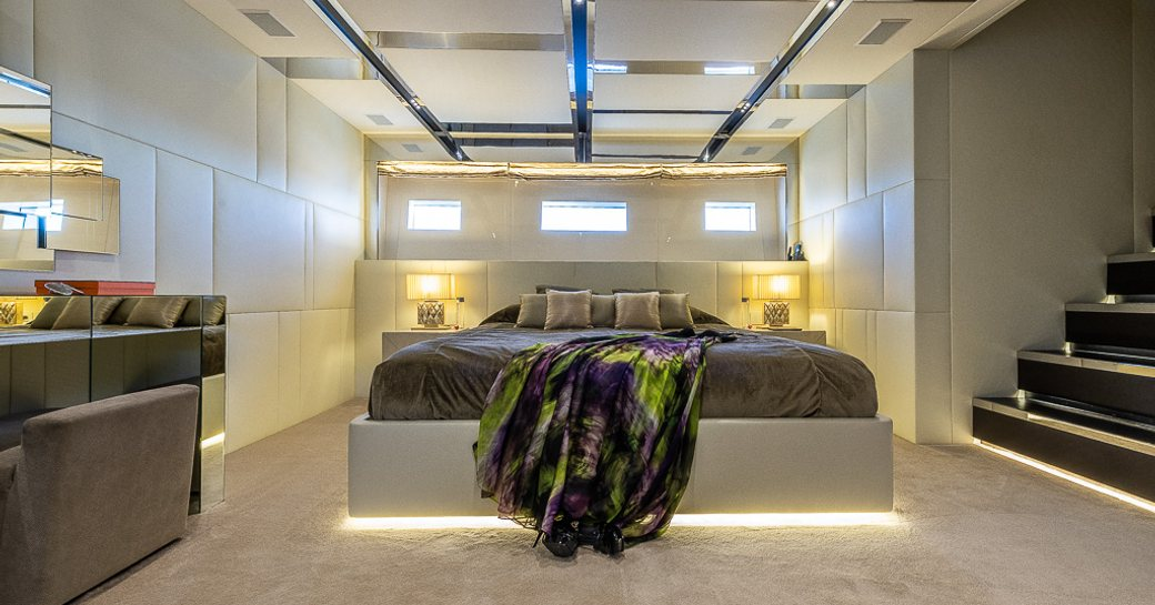 Large cabin with double bed and stairs visible on motor yacht Cinquanta 50