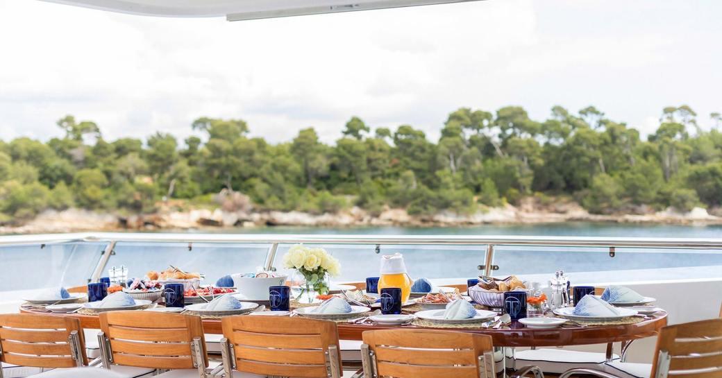 dining set up overlooking mediterranean island